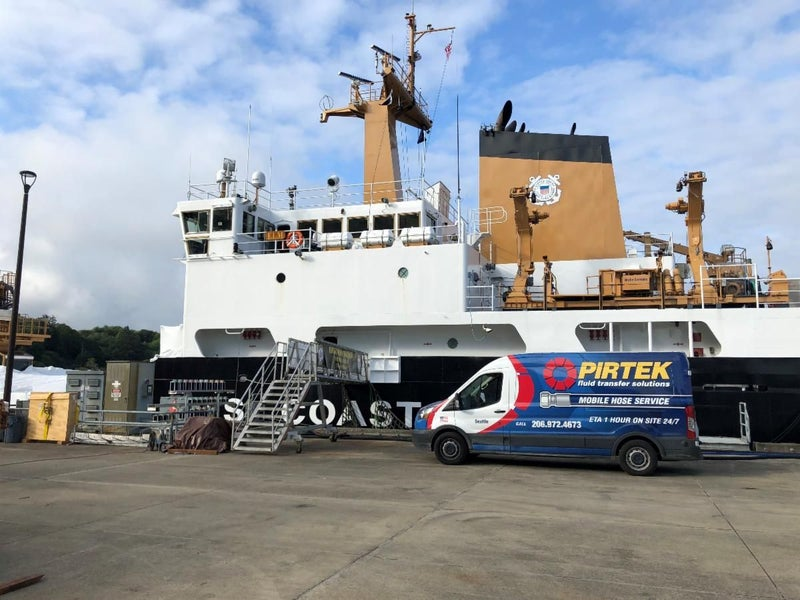 Pirtek vehicle at the port with a ship.