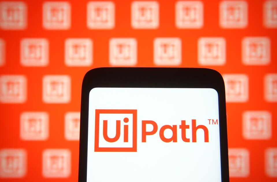 In this photo illustration, the UiPath logo is a software ...